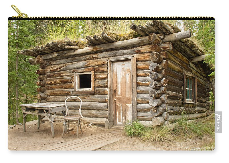 Architecture Carry-all Pouch featuring the photograph Old Traditional Log Cabin Rotting In Yukon Taiga by Stephan Pietzko