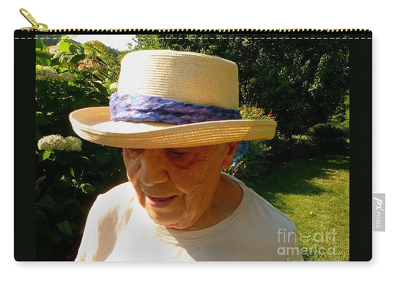 Old Woman Carry-all Pouch featuring the photograph Old Woman Wearing Straw Hat by Afroditi Katsikis