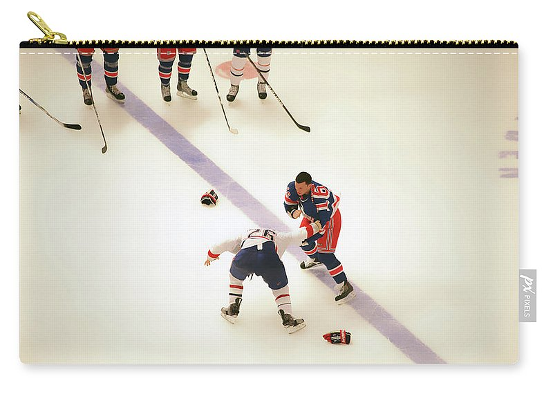 Hockey Carry-all Pouch featuring the photograph One Two Punch by Karol Livote