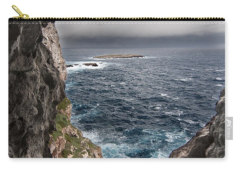 Background Carry-all Pouch featuring the photograph A Natural Window In Minorca North Coast Discover Us An Impressive View Of Sea And Sky - Open Window by Pedro Cardona Llambias