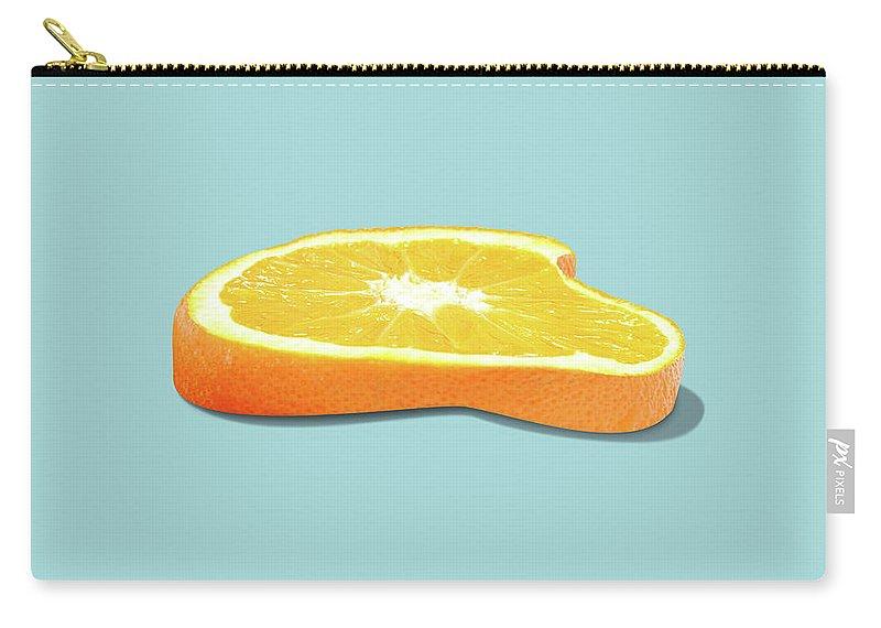 Orange Carry-all Pouch featuring the photograph Orange Fruit Slice by Dan Cretu