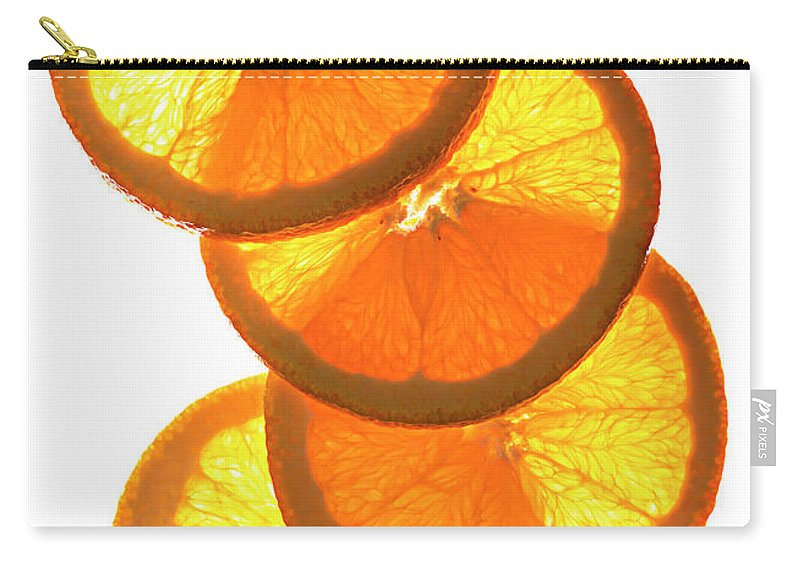 Orange Color Carry-all Pouch featuring the photograph Oranges On White by Jack Andersen