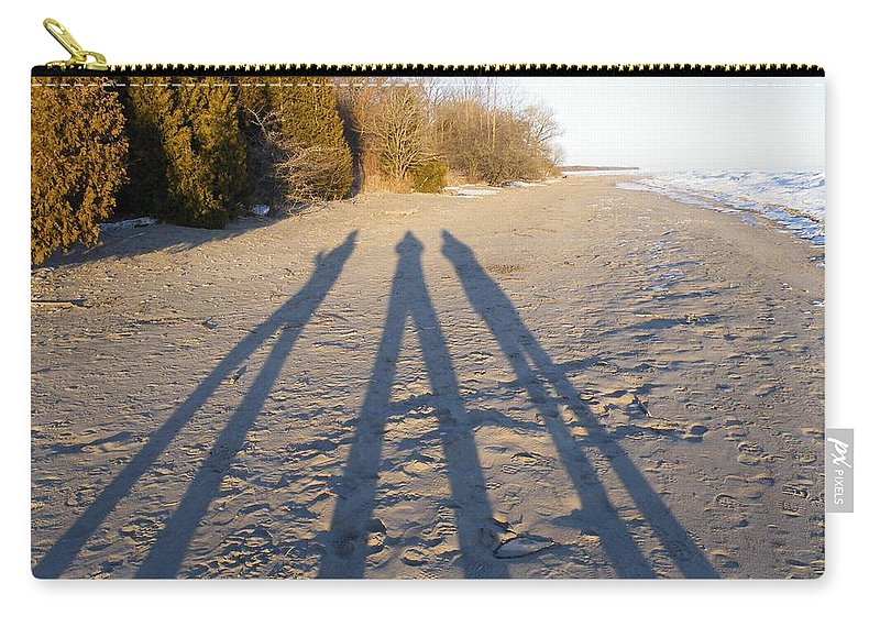 Beach Carry-all Pouch featuring the photograph Out Of The Shadows by Davandra Cribbie
