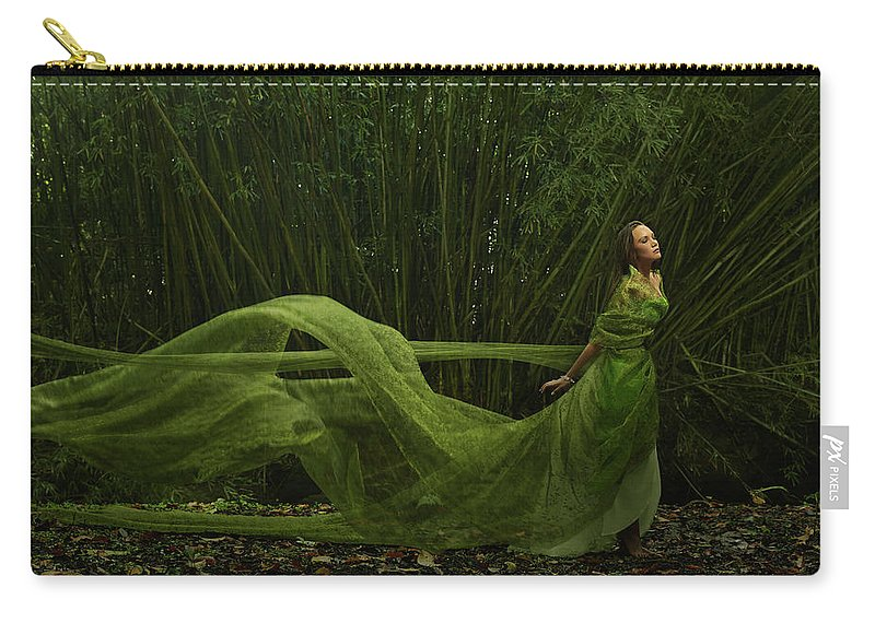 Tranquility Carry-all Pouch featuring the photograph Pacific Islander Woman In Flowing Green by Colin Anderson Productions Pty Ltd