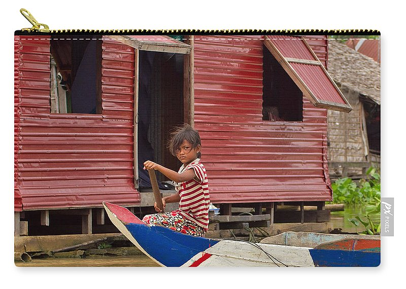 Cambodia Carry-all Pouch featuring the photograph Paddling Through The Village by David Freuthal