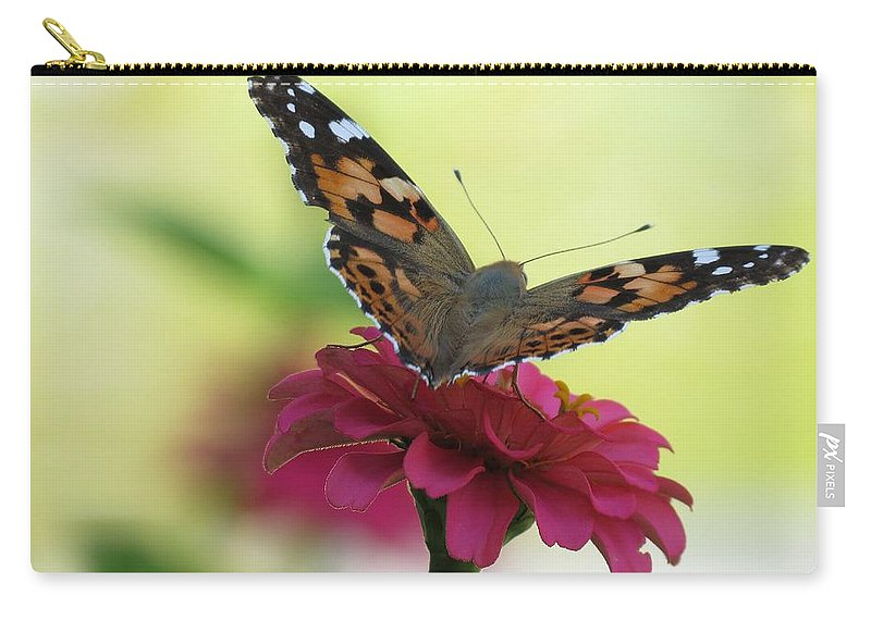 Butterfly Carry-all Pouch featuring the photograph Painted Lady Butterfly On Zinnia by MTBobbins Photography