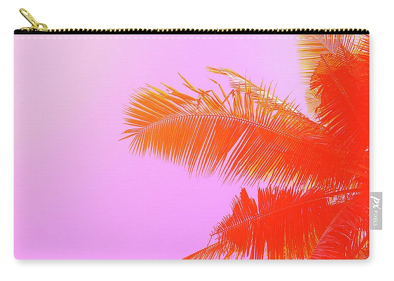 Orange Color Carry-all Pouch featuring the photograph Palm Tree On Sky Background. Palm Leaf by Slavadubrovin