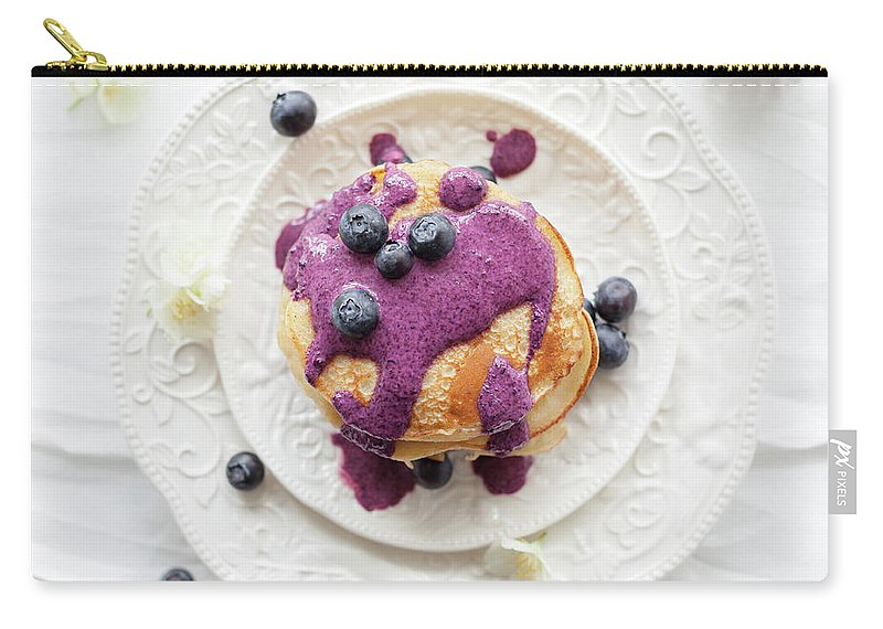 Temptation Carry-all Pouch featuring the photograph Pancakes With Blueberry Sauce by Ingwervanille