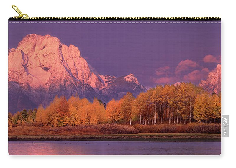America Carry-all Pouch featuring the photograph Panorama Dawn Lights Up Mount Moran In Grand Tetons National Park by Dave Welling
