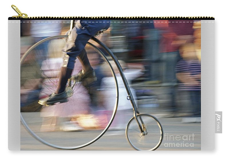 Bicycle Carry-all Pouch featuring the photograph Pedaling Past by Ann Horn