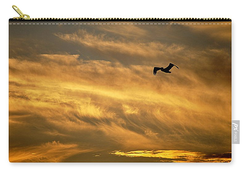 Scenic Carry-all Pouch featuring the photograph Pelican Against The Golden Sky by AJ Schibig