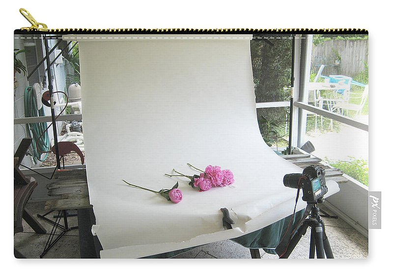 Peonies Carry-all Pouch featuring the photograph Peonies And Paper Backdrop by Rich Franco