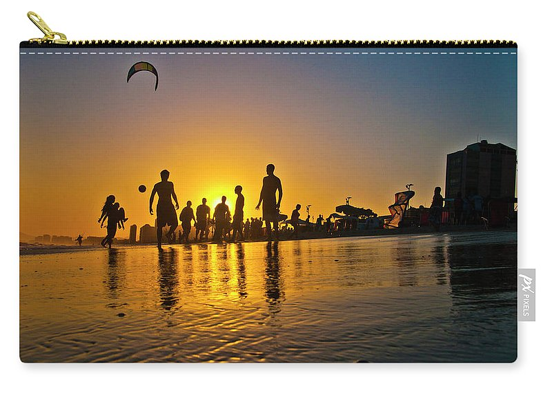 Parachuting Carry-all Pouch featuring the photograph People Having Fun In The Beach by Giovani Cordioli