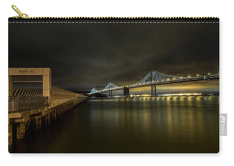 San Francisco Carry-all Pouch featuring the photograph Pier 14 And Bay Bridge At Night by John Daly