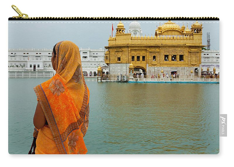 Indian Subcontinent Ethnicity Carry-all Pouch featuring the photograph Pilgrim In Golden Temple Amritsar, India by Prognone