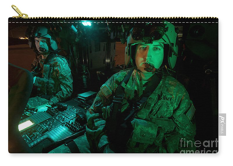 Exercise Angel Thunder Carry-all Pouch featuring the photograph Pilots Sitting In The Cockpit by Terry Moore