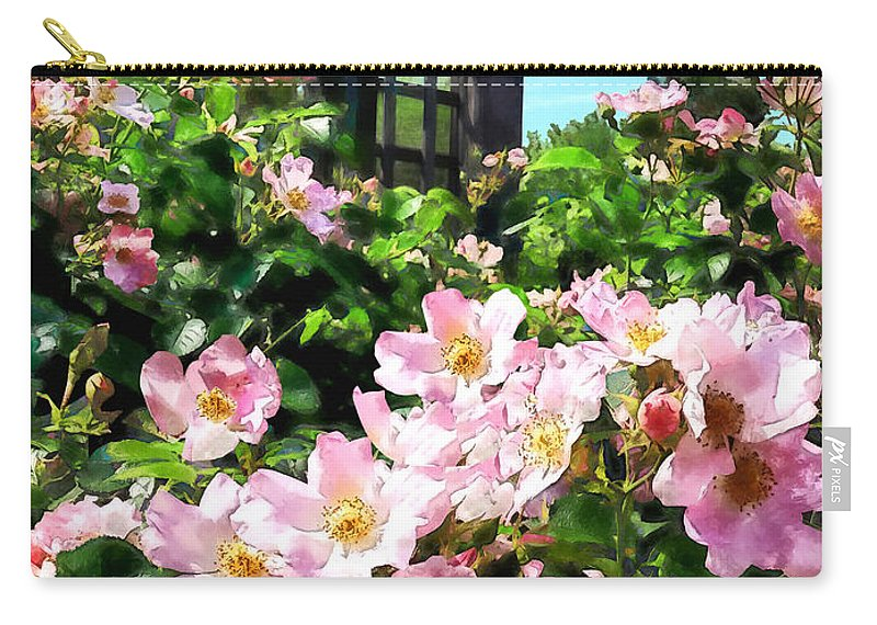 Rose Carry-all Pouch featuring the photograph Pink Roses Near Trellis by Susan Savad