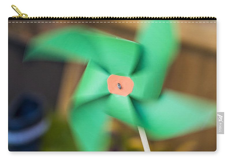 Beautiful Carry-all Pouch featuring the photograph Pinwheel by Paulo Goncalves
