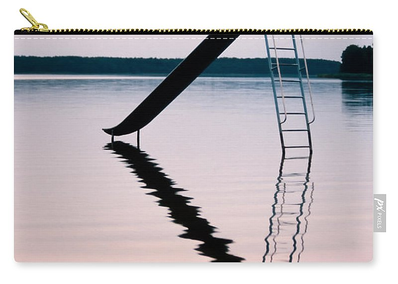 Aquatics Carry-all Pouch featuring the photograph Playground Slide In Lake by Stephan Pietzko