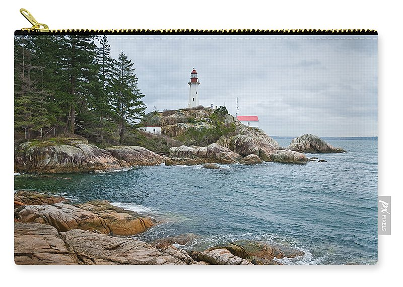 Architecture Carry-all Pouch featuring the photograph Point Atkinson Lighthouse And Rocky Shore by Jeff Goulden
