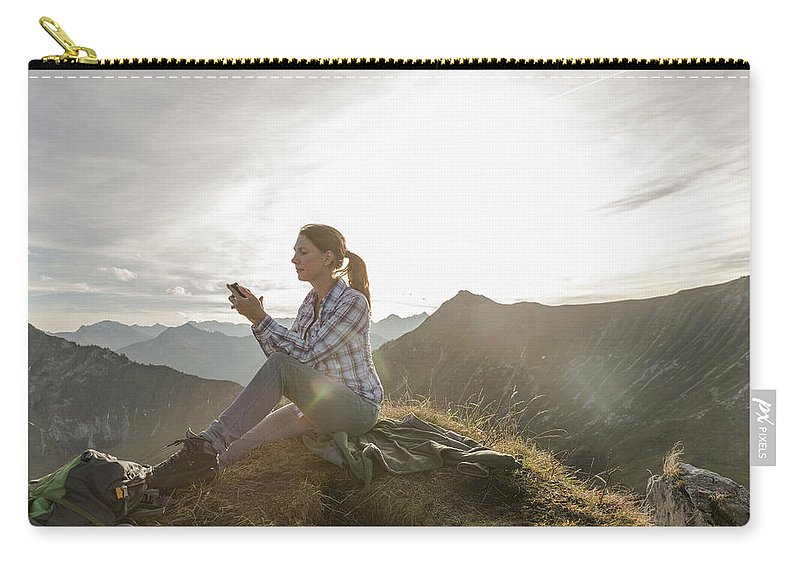 Mid Adult Women Carry-all Pouch featuring the photograph Portrait Of A Mid Adult Woman by Alan Graf