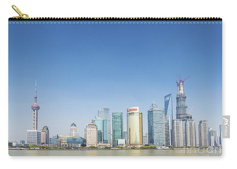 Architecture Carry-all Pouch featuring the photograph Pudong Skyline In Shanghai China by Jacek Malipan