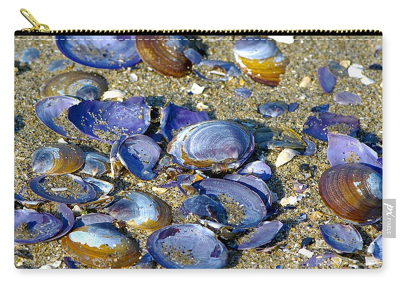 Purple Clam Shells Carry-all Pouch featuring the photograph Purple Clam Shells On A Beach by Sharon Talson