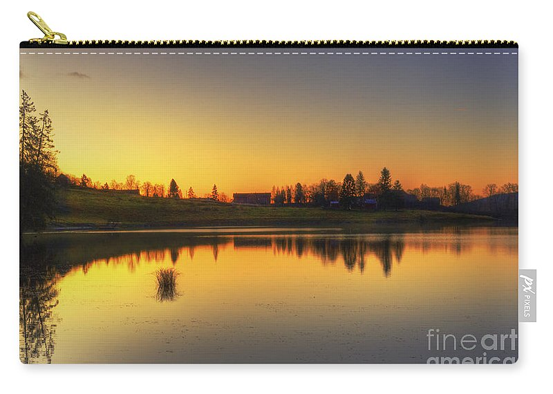 Sunrise Carry-all Pouch featuring the photograph Quiet Sunrise.. by Nina Stavlund