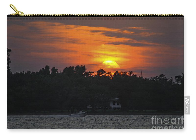 Sunset Carry-all Pouch featuring the photograph Racing Against The Sunset by Dale Powell