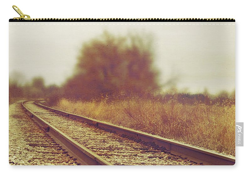 Rail; Railroad; Tracks; Train Tracks; Barren; Empty; Rocks; No One; Metal; Line; Iron; Ties; Gravel; Transportation; Stone; Pebbles; Rural; Vanishing Point; Outside; Outdoors; Route; Sepia; Vintage; Brush; Bush; Grasses; Transportation Carry-all Pouch featuring the photograph Rail by Margie Hurwich
