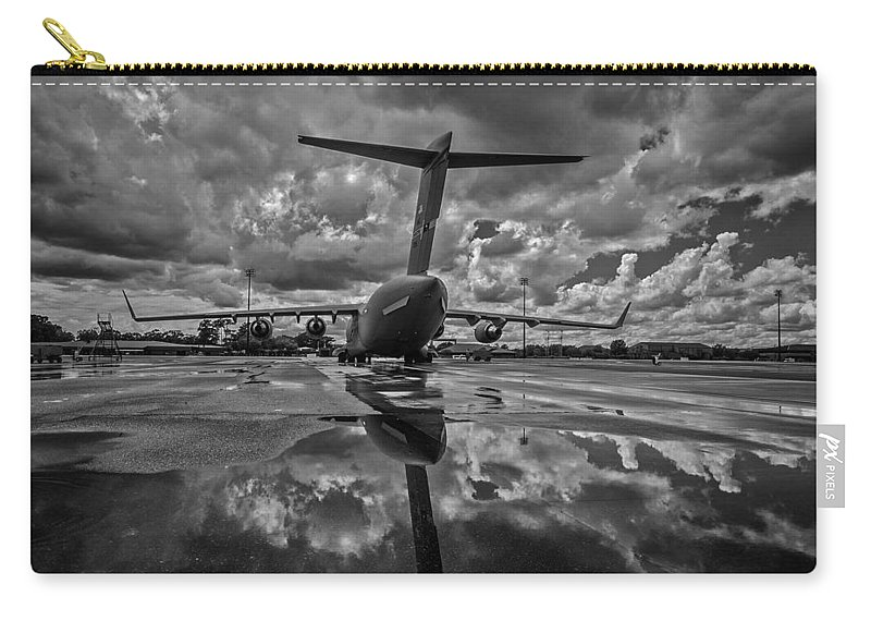 Plane Carry-all Pouch featuring the photograph Rain At The Base by Mountain Dreams