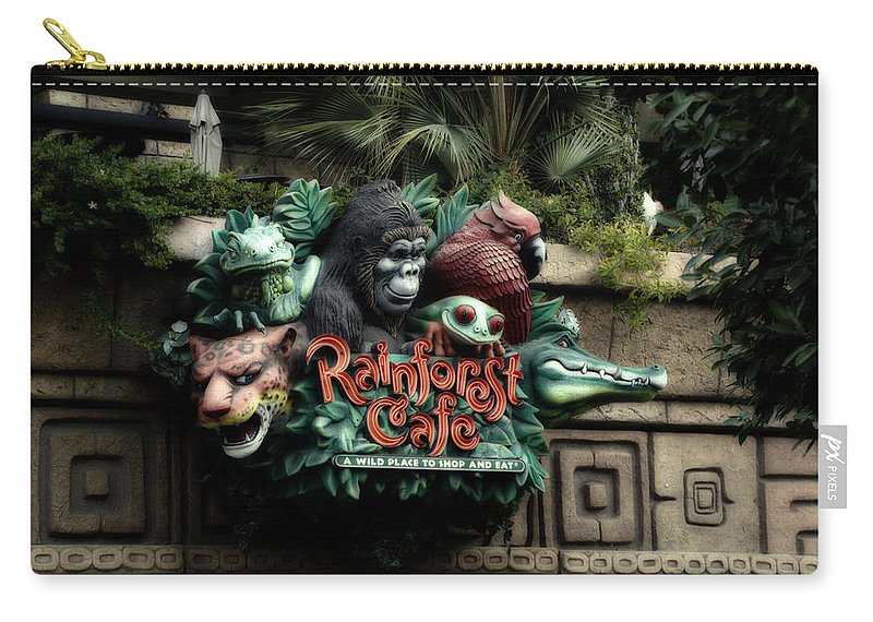 Disney Carry-all Pouch featuring the photograph Rain Forest Cafe Signage Downtown Disneyland 03 by Thomas Woolworth