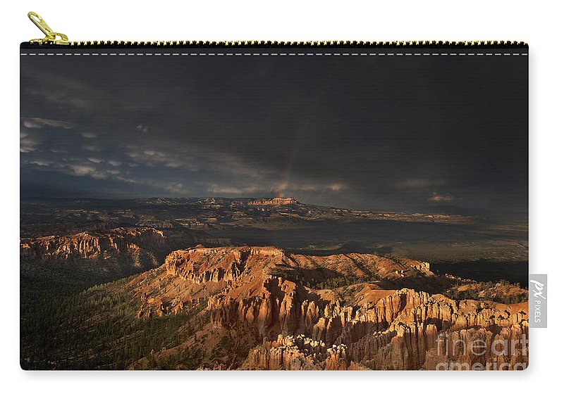 North America Carry-all Pouch featuring the photograph Rainbow And Thunderstorm Over The Paunsaugunt Plateau by Dave Welling