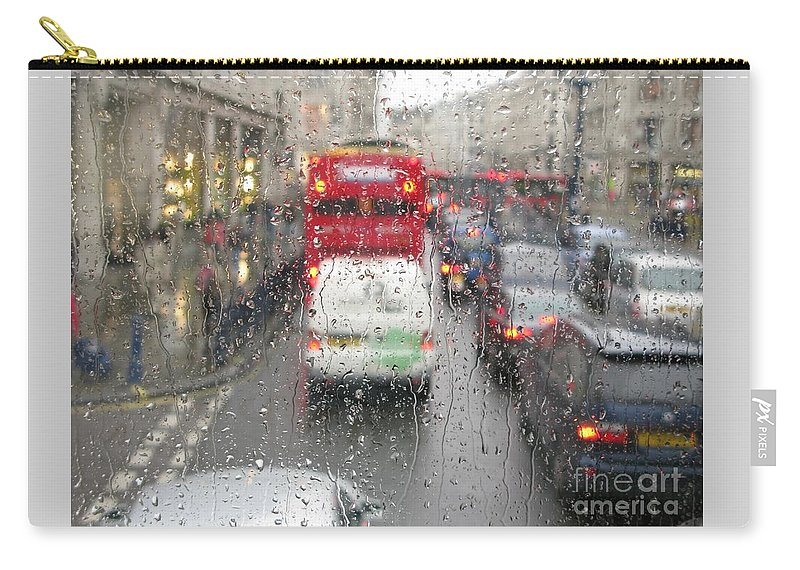 Rainy Day London Traffic By Ann Horn Carry-all Pouch featuring the photograph Rainy Day London Traffic by Ann Horn