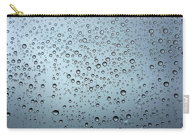 Horizontal Carry-all Pouch featuring the photograph Rainy Day Out by Nigel Killeen