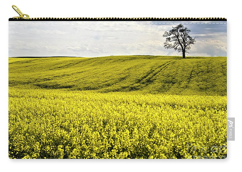 Heiko Carry-all Pouch featuring the photograph Rape Landscape With Lonely Tree by Heiko Koehrer-Wagner
