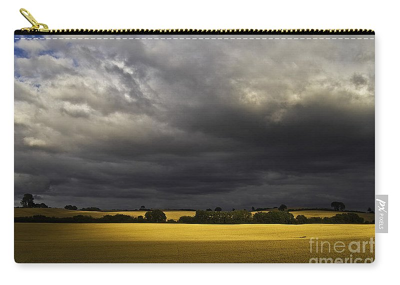 Rapefield Carry-all Pouch featuring the photograph Rapefield Under Dark Sky by Heiko Koehrer-Wagner
