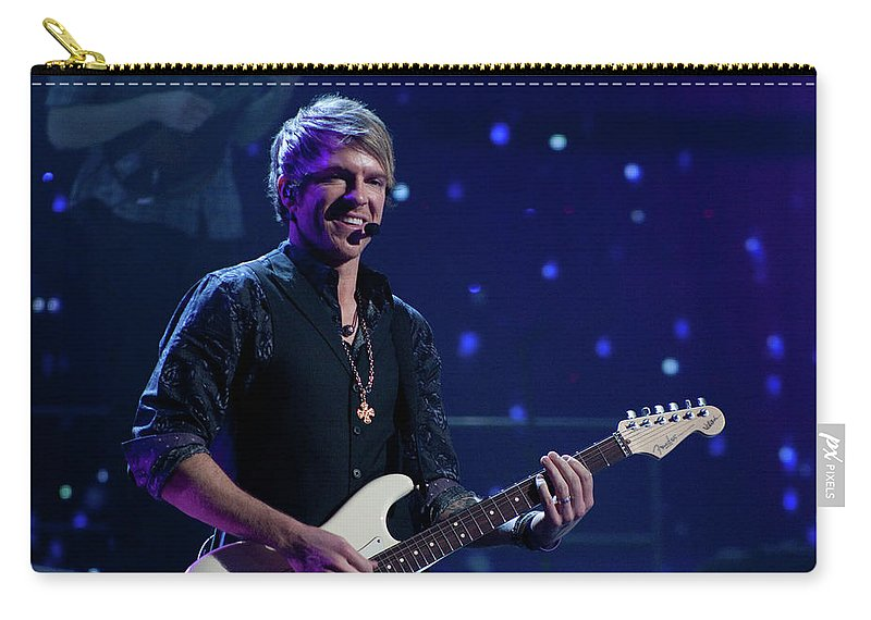 Rascal Flatts Carry-all Pouch featuring the photograph Rascal Flatts 4991 by Timothy Bischoff