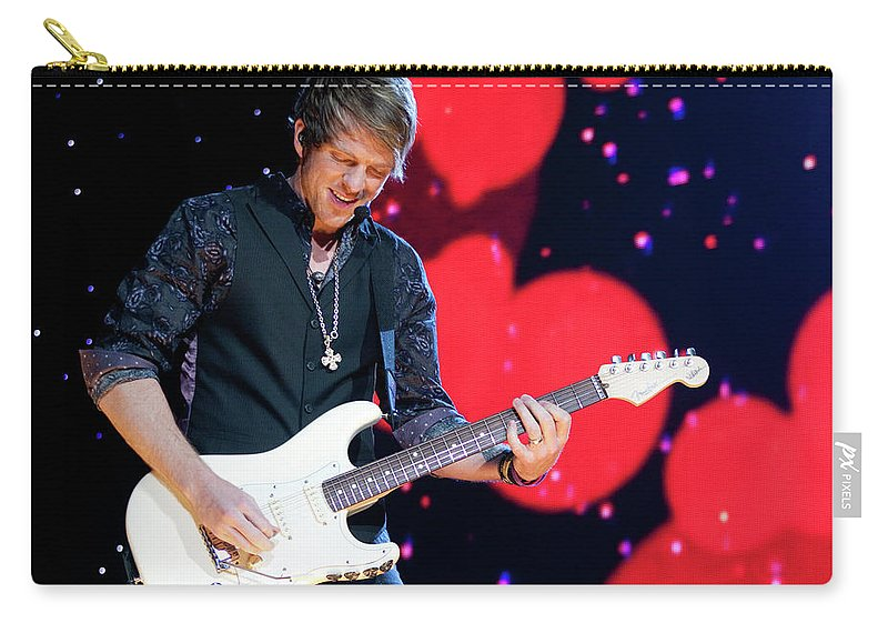 Rascal Flatts Carry-all Pouch featuring the photograph Rascal Flatts 5180 by Timothy Bischoff
