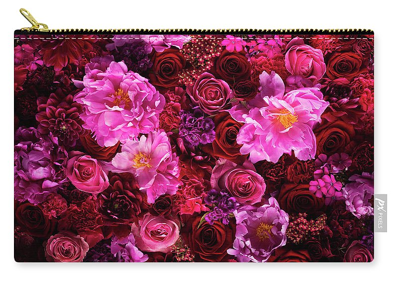 Tranquility Carry-all Pouch featuring the photograph Red And Pink Cut Flowers, Close Up by Jonathan Knowles