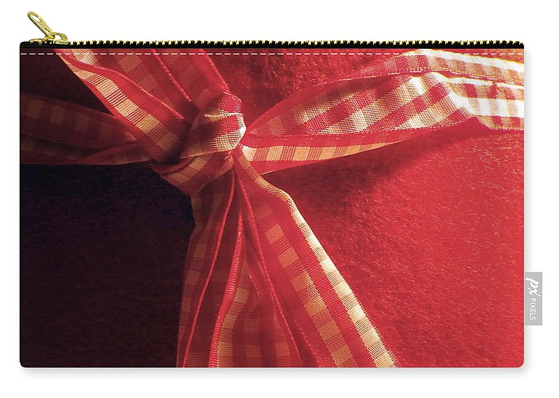 Red Carry-all Pouch featuring the photograph Red Bow by Brainwave Pictures