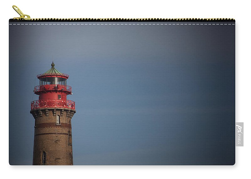 Island Of Ruegen Carry-all Pouch featuring the photograph Red Lighthouse by Ralf Kaiser