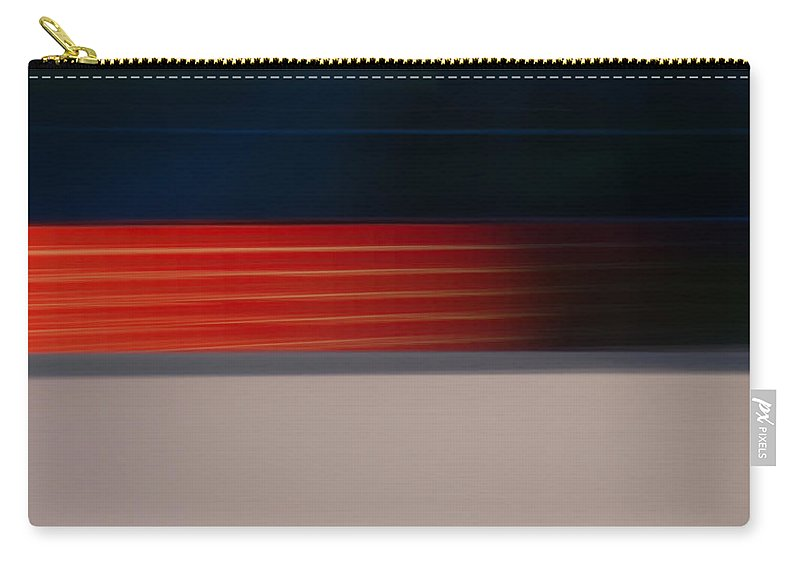 Motion Blur Carry-all Pouch featuring the photograph Red Stripe Disappearing by Dayne Reast