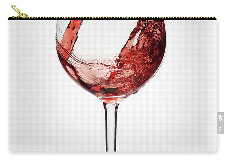 Alcohol Carry-all Pouch featuring the photograph Red Wine Being Poured Into A Glass by Dual Dual