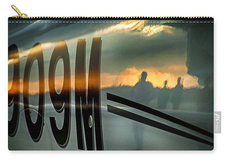 Airplane Carry-all Pouch featuring the photograph Reflections Of A Sunset Flight by Carolyn Marshall