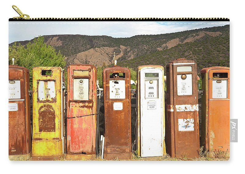 Home Decor Carry-all Pouch featuring the photograph Retro Gas Pumps In Outdoor Museum Nm by Helovi