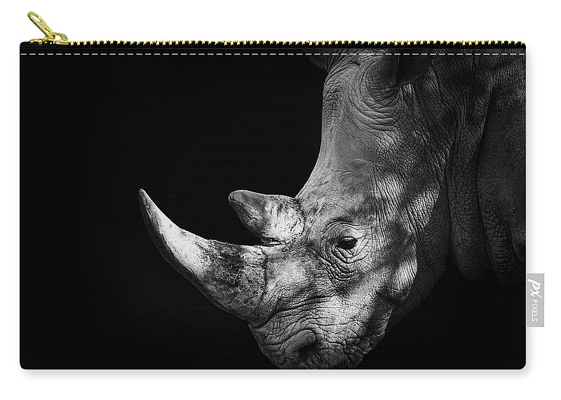 Horned Carry-all Pouch featuring the photograph Rhinoceros by Malcolm Macgregor