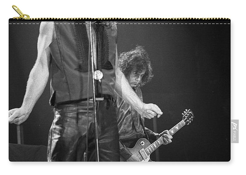 Robert Plant Carry-all Pouch featuring the photograph Robert Plant And Jimmy Page by Timothy Bischoff