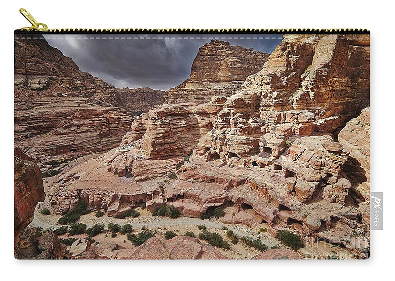 Jordan Carry-all Pouch featuring the photograph rock landscape with simple tombs in Petra by Juergen Ritterbach