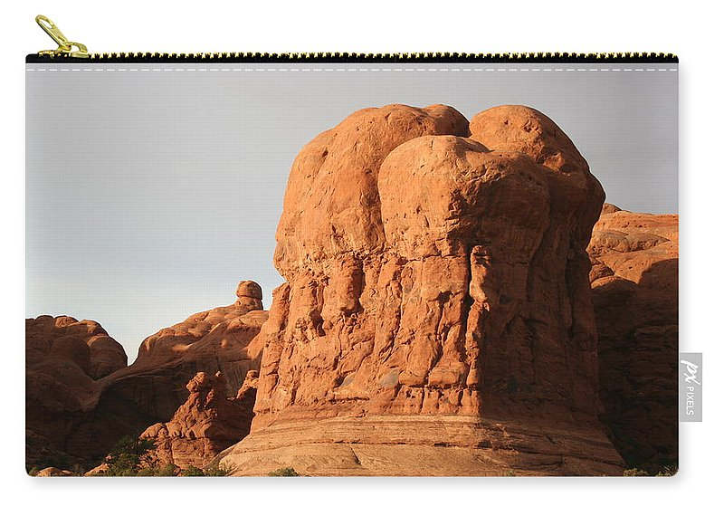Rocks Carry-all Pouch featuring the photograph Rockformation Arches Park by Christiane Schulze Art And Photography